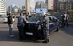 A policeman books a driver for having violated the lockdown imposed by the authorities in a bid to slow the spread of the coronavirus, in Beirut, Lebanon, on January 7, 2021. Since the start of the Covid-19 pandemic, Lebanon has recorded nearly 200,000 cases including 1,537 deaths, according to health ministry figures. Health professionals have warned that the latest surge in cases risked causing catastrophe across Lebanon, which is already suffering from the aftermath of a devastating August explosion in Beirut and a dire economic crisis. Photo by Marwan Bou Haidar