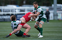 Reece Marshall of Jersey Reds is tackled by Elliot Millar Mills of Ealing Trailfinders and Rayn Smid during the Championship Cup Quarter final match between Ealing Trailfinders and Jersey Reds at Castle Bar , West Ealing , England  on 22 February 2020. Photo by Alan  Stanford / PRiME Media Images.