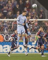 Colorado Rapids midfielder Colin Clark (23) and New England Revolution midfielder Steve Ralston (14) battle for a head ball. The New England Revolution tied the Colorado Rapids, 1-1, at Gillette Stadium on May 16, 2009.