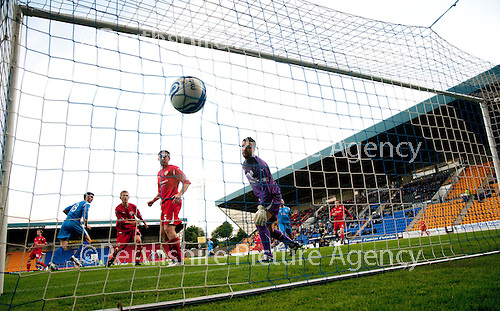 St Johnstone v Morton..24.08.10  CIS Cup Round 2.Kevin Cuthbert can only turn and watch as Scot Dobie's header hits the back of the net to give saints a 1-0 lead..Picture by Graeme Hart..Copyright Perthshire Picture Agency.Tel: 01738 623350  Mobile: 07990 594431