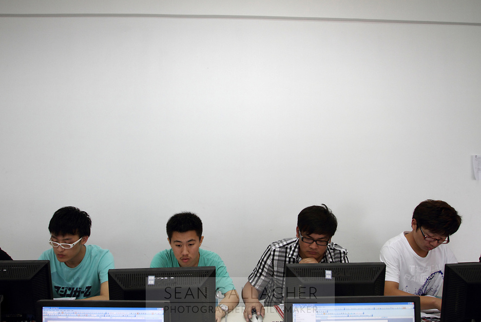CHINA. Beijing. Students during class at Aoji, an organisation which assists Chinese students in language training and placing them in overseas universities throughout the world. 2010