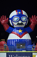 """A giant inflatable bounce house in the shape of Kannapolis Cannon Ballers mascot """"Boomer"""" sits on the concourse beyond the left field wall during the game against the Columbia Fireflies at Atrium Health Ballpark on May 18, 2021 in Kannapolis, North Carolina. (Brian Westerholt/Four Seam Images)"""