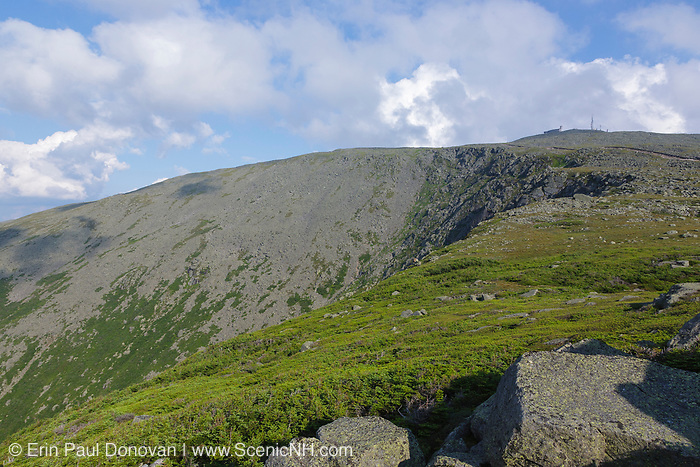Mount Washington from Mount Clay in Thompson and Meserve's Purchase, New Hampshire on a cloudy day. The Appalachian Trail crosses over the summit of Mount Washington. The steep cliff is the Great Gulf headwall.