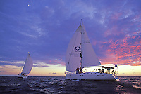 Group of sailors enjoying a spectacular sunset in the waters off Ko Olina, West Side of Oahu