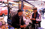 Street market London. Golborne Road north end of Portobello Road.  Saturday traditional fruit market stall. Market stall holders. 1990s UK 1999. Golborne Road was where much of the film Notting Hill was shot on location.