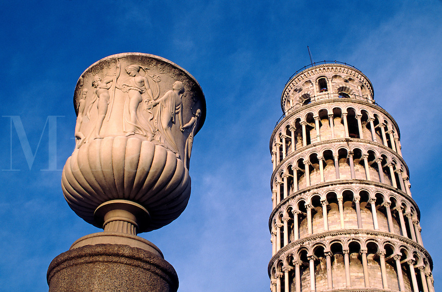 Marble Urn stands on a pillar near the LEANING TOWER OF PISA (begun in 1174 AD) which is still settling  - PISA, ITALY