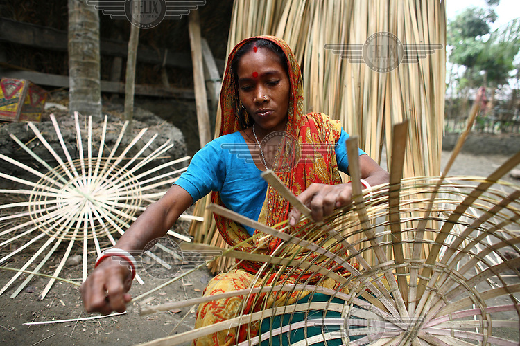 36 year old Alo Rani received a microfinance loan from IFAD (International Fund for Agricultural Devlopment) to improve productivity of her family's cane and bamboo weaving business.