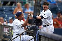 Charlotte Stone Crabs catcher Brett Sullivan (8) is congratulated as he returns to the dugout after hitting a home run in the bottom of the seventh inning during the first game of a doubleheader against the Tampa Yankees on July 18, 2017 at Charlotte Sports Park in Port Charlotte, Florida.  Charlotte defeated Tampa 7-0 in a game that was originally started on June 29th but called to inclement weather.  (Mike Janes/Four Seam Images)