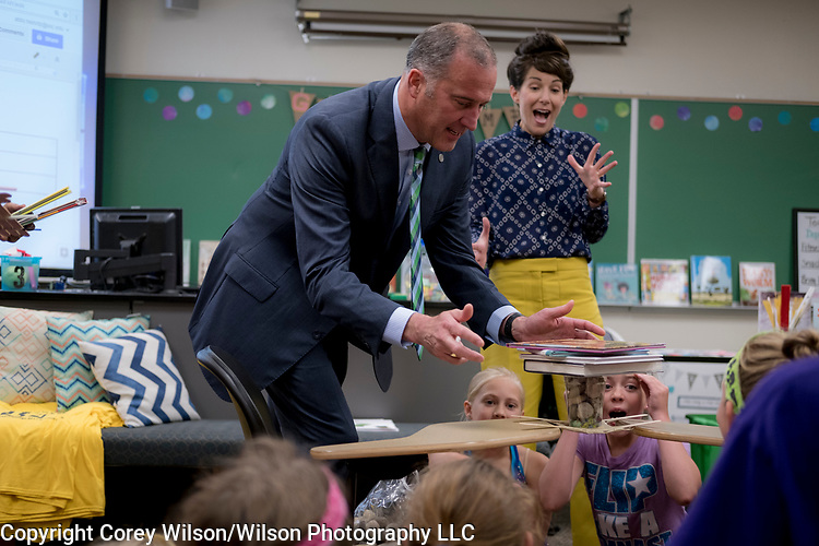 Incoming St. Norbert College President Brian Bruess with his wife Carol interact with girls from GLAD camp at the campus in De Pere, Wis., on June 29, 2017.