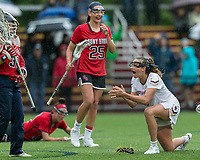 Newton, Massachusetts - May 19, 2018: NCAA Division I tournament, third round. In overtime, Boston College (white) defeated Stony Brook University (red/blue), 12-11, at Newton Campus Lacrosse Field.<br /> Goal celebration.