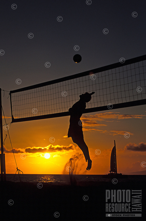 A male volleyball player in action at sunset on Kaanapali Beach