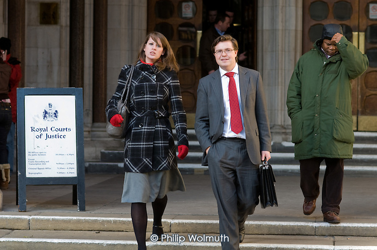 Lawyers and litigants leave the Royal Courts of Justice, London