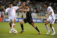 Costa Rica's Oscar Duarte attempts to knock the ball away from Mexico's Gerardo Torrado as Costa Rica's Jose Salvatierra looks on.  Mexico defeated Costa Rica 4-1 at the 2011 CONCACAF Gold Cup at Soldier Field in Chicago, IL on June 12, 2011.