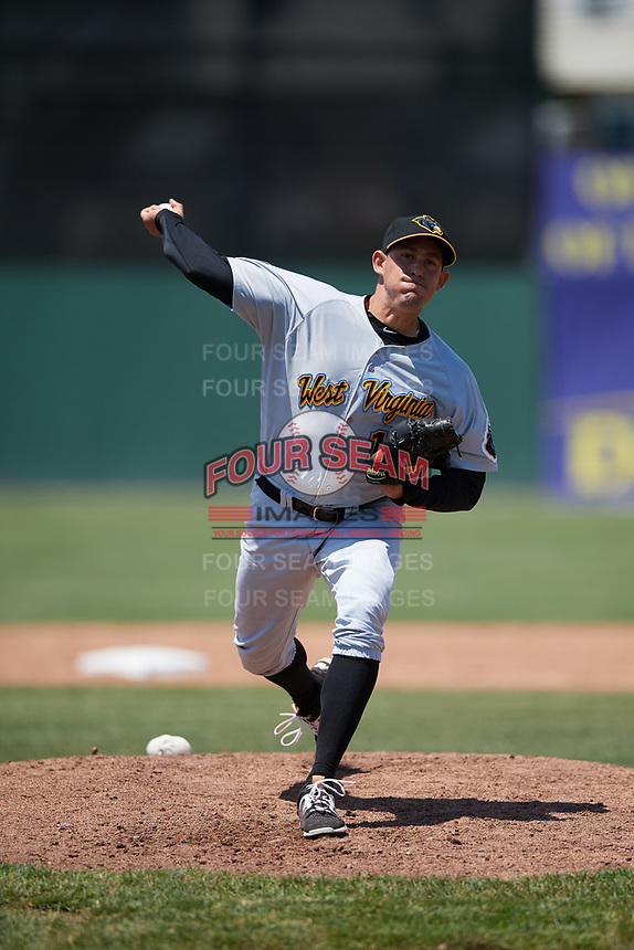 West Virginia Black Bears relief pitcher Yoandy Fernandez (19) delivers a warmup pitch during a game against the Batavia Muckdogs on June 25, 2017 at Dwyer Stadium in Batavia, New York.  West Virginia defeated Batavia 6-4 in the completion of the game started on June 24th.  (Mike Janes/Four Seam Images)