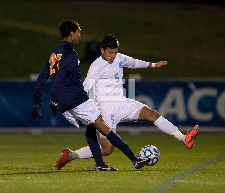 Mikey Lopez (5) of North Carolina tries to stop the pass of Jordan Poarch (27) of Virginia during the game at the Maryland SoccerPlex in Germantown, MD. North Carolina defeated Virginia on penalty kicks after playing to a 0-0 tie in regulation time.  With the win the Tarheels advanced to the finals of the ACC men's soccer tournament.