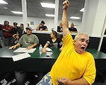 (Boston Ma 060615) Jim Pettinicchio, 48, of Revere, cheers on American Pharoah, during the Belmont Stakes, Saturday, June 6, 2015, at Suffolk Downs in Boston. Behind him is his daughter Taylor, 14, and Joe Santoro, 60, also of Revere. Herald Photo by Jim Michaud