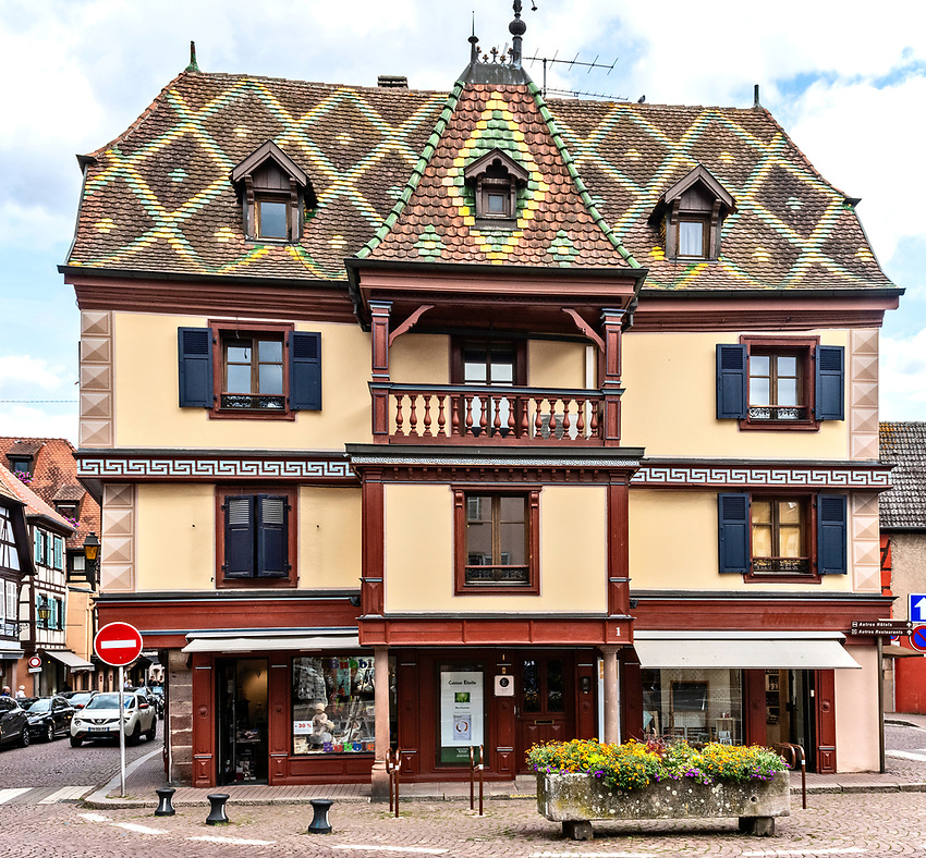 Office building with patterned tile roof, in Obernai