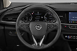 Car pictures of steering wheel view of a 2021 Opel Insignia Ultimate 4 Door Sedan Steering Wheel
