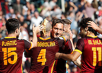 Calcio, Serie A: Roma vs Napoli. Roma, stadio Olimpico, 25 aprile 2016.<br /> Roma's Radja Nainggolan, second from left, celebrates with teammates Miralem Pjanic, left, Francesco Totti,second from right, and Mohamed Salah, after scoring the winning goal during the Italian Serie A football match between Roma and Napoli at Rome's Olympic stadium, 25 April 2016. Roma won 1-0.<br /> UPDATE IMAGES PRESS/Riccardo De Luca