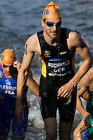 12 JUL 2014 - HAMBURG, GER - Gregor Buchholz (GER) (right) from Germany heads for transition at the end of the swim at the elite men's 2014 ITU World Triathlon Series round in the Altstadt Quarter, Hamburg, Germany (PHOTO COPYRIGHT © 2014 NIGEL FARROW, ALL RIGHTS RESERVED)