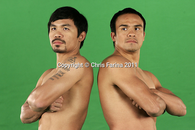 Sept. 6, 2011, New York, N.Y.  ---  (L-R) Superstar Manny Pacquiao and three-division world champion Juan Manuel Marquez poses during a commercial shoot in New York Tuesday to kick off their North American world tour to announce the third world Welterweight title mega-fight of the Pacquiao-Marquez trilogy. Promoted by Top Rank, in association with MP Promotions,Marquez Boxing,Tecate and MGM Grand, Pacquiao vs Marquez III will take place, Saturday, Nov. 12 at the MGM Grand in Las Vegas and be produced and distributed by HBO Pay Per View.   --- Photo Credit : Chris Farina - Top Rank  (no other credit allowed)  copyright 2011