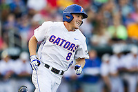 Florida Gators outfielder Harrison Bader (8) rounds first base against the Miami Hurricanes in the NCAA College World Series on June 13, 2015 at TD Ameritrade Park in Omaha, Nebraska. Florida defeated Miami 15-3. (Andrew Woolley/Four Seam Images)