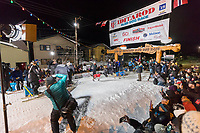 Joar Leifseth Ulsom runs across the finish line in Nome, Alaska early on Wednesday morning March 14th as he wins the 46th running of the 2018 Iditarod Sled Dog Race.  He finished in 9 days 12 hours 00 minutes and 00 seconds<br /> <br /> Photo by Jeff Schultz/SchultzPhoto.com  (C) 2018  ALL RIGHTS RESERVED