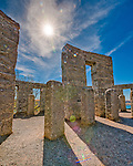 Sunburst accents the blue skies over the Stonehenge Memorial in Maryhill, Washington built by Samuel Hill