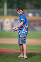 A Missoula Osprey fan throws out the first pitch before a Pioneer League game between the Missoula Osprey and the Orem Owlz at Ogren Park Allegiance Field on August 19, 2018 in Missoula, Montana. The Missoula Osprey defeated the Orem Owlz by a score of 8-0. (Zachary Lucy/Four Seam Images)