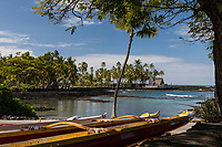 Pu'uhonua o Honaunau, an historic place of refuge and also a national historical park, with an outrigger canoe in the foreground, south Kona, Big Island of Hawai'i.