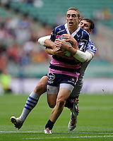 Steph Reynolds of Gloucester Rugby 7s is tackled by Nikolay Goroshilov of VVA Saracens Moscow during the World Club 7s at Twickenham on Saturday 17th August 2013 (Photo by Rob Munro)