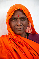 Jaipur, Rajasthan, India.  Woman with Bindi and Nose Ring. The bindi between her eyebrows, represents the third eye or spiritual sight that Hindus seek.  It is also said to protect against demons or bad luck.