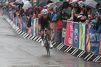 Sunday 3rd August 2014<br /> Pictured: Peter Kennaugh <br /> RE: Isle of Man cyclist Peter Kennaugh cycling in the rain at the Glasgow Commonwealth Games, Men's Road Race.