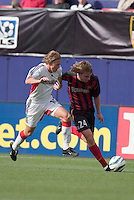 The MetroStars' Eddie Gaven is marked by D.C. United's Brian Carroll. D. C. United was defeated by the NY/NJ MetroStars 3 to 2 during the MetroStars home opener at Giant's Stadium, East Rutherford, NJ, on April 17, 2004.