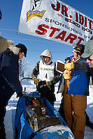 Cain Carter signs has his sled checked at the finish line of the 2009 Junior Iditarod in Willow, Alaska.   Cain is the step-son of current Iditarod champion Lance Mackey and ran Lance's Iditarod team to a first place finish.  March 1, 2009