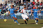 Getafe´s Alexis and Naldo and Sevilla´s Bacca during 2014-15 La Liga match at Alfonso Perez Coliseum stadium in Getafe, Spain. February 08, 2015. (ALTERPHOTOS/Victor Blanco)