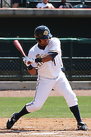 Zoilo Almonte #7 of the Charleston RiverDogs batting in a game against the West Virginia Power on April 14 2010  in Charleston, SC.