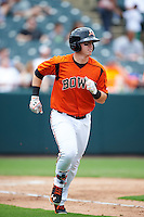 Bowie Baysox designated hitter Chance Sisco (12) runs to first base during the first game of a doubleheader against the Akron RubberDucks on June 5, 2016 at Prince George's Stadium in Bowie, Maryland.  Bowie defeated Akron 6-0.  (Mike Janes/Four Seam Images)