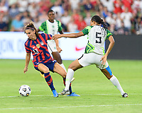 AUSTIN, TX - JUNE 16: Alex Morgan #13 of the United States and Onome Ebi #5 of Nigeria battle for control of the ball during a game between Nigeria and USWNT at Q2 Stadium on June 16, 2021 in Austin, Texas.