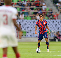 AUSTIN, TX - JULY 29: Miles Robinson #12 of the United States looks to pass the ball during a game between Qatar and USMNT at Q2 Stadium on July 29, 2021 in Austin, Texas.