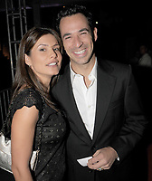 """MIAMI - MARCH 07:(EXCLUSIVE COVERAGE)    Hélio Castroneves ( the two-time Indianapolis 500 winner and TV """"Dancing With the Stars"""" champion, was indicted  on tax evasion and tax fraud charges)  and girlfriend Adriana Henao (wardrobe malfunctions)  share a kiss at the Destination Fashion 2009 at the Bal Harbour Shops on March 7, 2009 in Miami, Florida<br /> <br /> People:  Katicia Castroneves , Adriana Henao"""