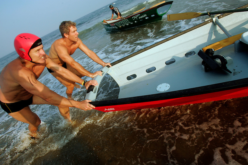 Dave Healy (left) and partner Warren Towns move their boat into position for the 3,000-meter surfboat event at the First Annual Asbury Park Beach Bar Lifeguard Competition held at the 3rd Avenue beach in Asbury Park.  Healy and Towns were the winners of this event. ASBURY PARK, NJ  8/4/07  8:21:47 PM  PHOTO BY ANDREW MILLS