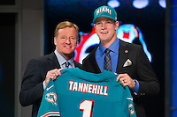 The eighth overall pick quarterback Ryan Tannehill (Texas A&M) of the Miami Dolphins with NFL commissioner Roger Goodell during the first round of the 2012 NFL Draft at Radio City Music Hall in New York, NY, on April 26, 2012.