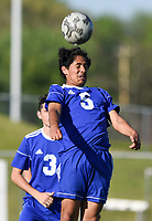 NWA Democrat-Gazette/CHARLIE KAIJO Rogers High School Cesar Perez (5) heads the ball during a soccer game, Friday, April 26, 2019 at  Whitey Smith Stadium at Rogers High School in Rogers.