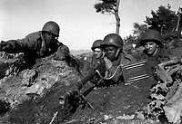 Fighting with the 2nd Inf. Div. north of the Chongchon River, Sfc. Major Cleveland, weapons squad leader, points out communist-led North Korean position to his machine gun crew.  November 20, 1950.  Pfc. James Cox. (Army)<br /> NARA FILE #:  111-SC-353469<br /> WAR & CONFLICT BOOK #:  1426