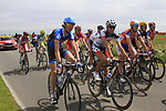 The peloton including Johan Van Summeren (BEL) Garmin-Sharp and Jelle Vanendert (BEL) Loto-Belisol pass through flat farmland near the village of Limont during Stage 2 of the 99th edition of the Tour de France 2012, running 207.5km from Vise to Tournai, Belgium. 2nd July 2012.<br /> (Photo by Eoin Clarke/NEWSFILE)
