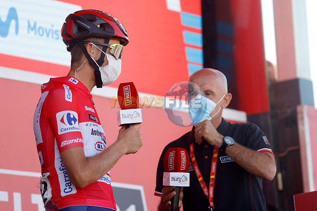 Race leader Odd Christian Eiking (NOR) Intermarché-Wanty-Gobert Matériaux at sign on before the start of Stage 15 of La Vuelta d'Espana 2021, running 197.5km from Navalmoral de la Mata to El Barraco, Spain. 29th August 2021.     <br /> Picture: Luis Angel Gomez/Photogomezsport | Cyclefile<br /> <br /> All photos usage must carry mandatory copyright credit (© Cyclefile | Luis Angel Gomez/Photogomezsport)