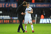 Graham Potter Manager of Swansea City celebrates with Daniel James of Swansea City at full time during the Sky Bet Championship match between Swansea City and Millwall at the Liberty Stadium in Swansea, Wales, UK. Saturday 09 February 2019