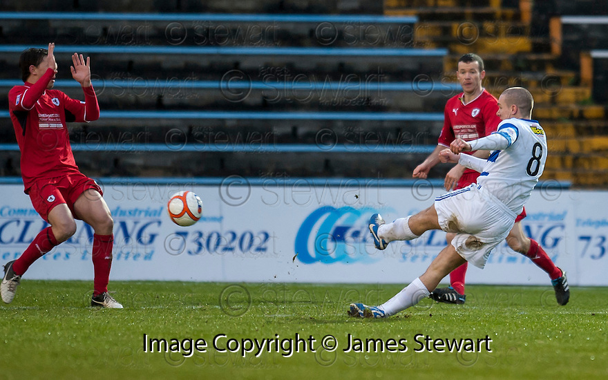 Morton's Michael Tidser scores their goal.