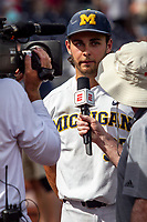 Michigan Wolverines pitcher Karl Kauffmann (37) is interviewed after Game 1 of the NCAA College World Series against the Texas Tech Red Raiders on June 15, 2019 at TD Ameritrade Park in Omaha, Nebraska. Michigan defeated Texas Tech 5-3. (Andrew Woolley/Four Seam Images)